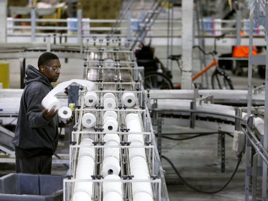 Jeff Smith mans a toilet paper conveyor belt at Kruger Products, a paper manufacturer north of downtown Memphis.