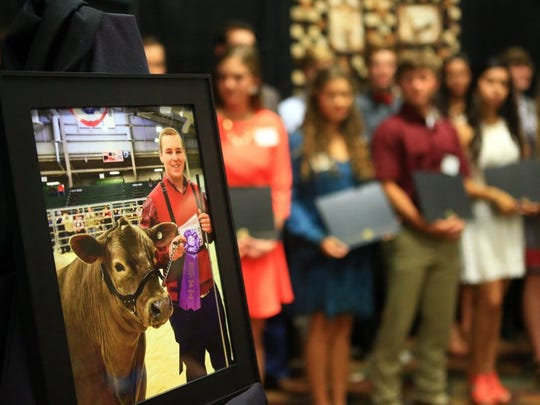 GABE HERNANDEZ/CALLER-TIMES A photo of Kollyn Barton from Banquete FFA is displayed next to other scholarship recipients during the Nueces County Junior Livestock Show Association Scholarship Awards on Tuesday, May 10, 2016, at the Richard M. Borchard Regional Fairgrounds in Robstown. He earned a scholarship at the show, but was killed in a wreck April 15.