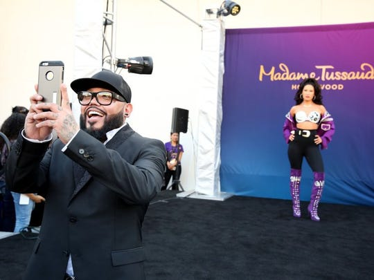 Selena's brother, A.B. Quintanilla, takes a photo after