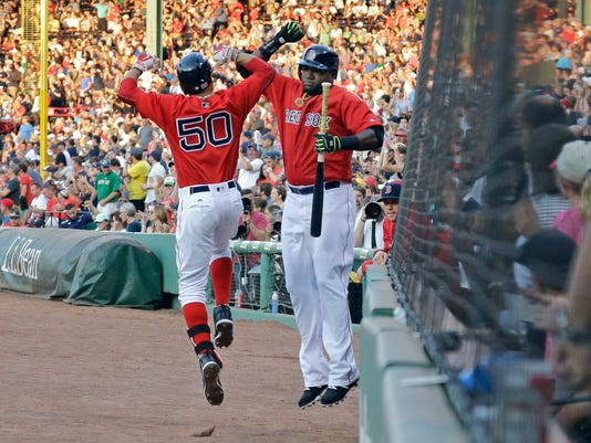 Boston Red Sox designated hitter David Ortiz celebrates with teammate Mookie Betts (50) after Betts hit a solo home run during the first inning of a baseball game against the Minnesota Twins at Fenway Park, Friday, July 22, 2016, in Boston. (AP Photo/Elise Amendola)