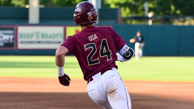 Florida State senior second baseman Matt Henderson (24) rounds first base during the Seminoles 5-3 victory over Pacific University on Saturday night at Dick Howser Stadium.