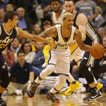 Pacers #3 George Hill moves through the crowd during the Utah Jazz at Indiana Pacers game, Saturday, October 31, 2015.  Utah's #25 Raulzinho Neto reaches in.  The Jazz won 97-76.