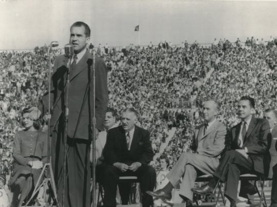 Vice President Richard Nixon speaks at halftime of the Packers-Bears game at the newly-completed City Stadium in 1957.