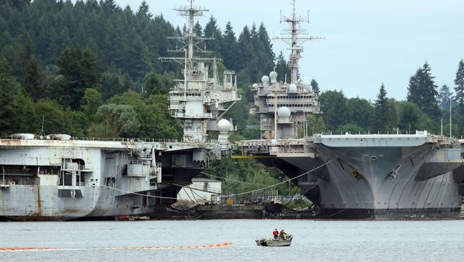 The USS Independence (left) and the USS Kitty Hawk in July 2015. MEEGAN M. REID / KITSAP SUN FILE