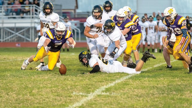 Douglass senior, Dylan Lockwood (7) dives after a loose ball on Friday, Sept. 25 at Douglass High School. Douglass fell 34-8 in the game.
