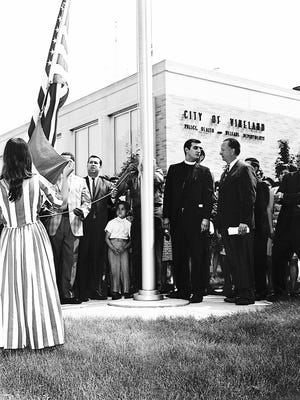 """A flag-raising is held in Vineland in 1969 to mark """"Puerto Rican Day,"""" a forerunner to today's Puerto Rican Festival."""