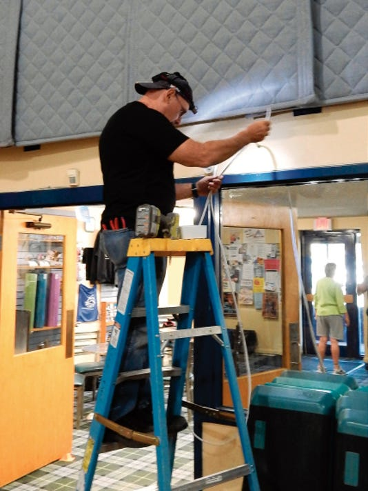 Loren Ross of GMR Electric working on wiring for surveillance cameras at the Ruidoso Athletic Club.