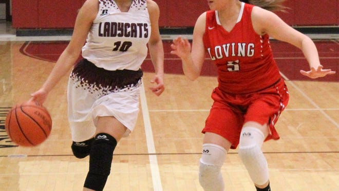 Tularosa's Bethany Betancur, left, brings the ball down the court while being guarded by Loving's Anyssa Rodriguez on Thursday night during the District 4-3A semifinal at the Michael Dorame Gymnasium.