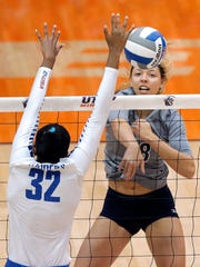 UTEP middle blocker Kylie Baumgartner hammers a hit