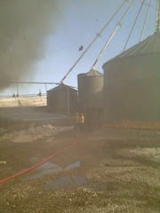Augusta volunteer firefighters battle a fire at the Milford Hutterite Colony on Monday.