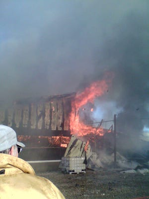 A fire destroys a barn at the Milford Hutterite Colony south of Augusta Monday.
