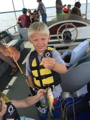 First of four fish caught by 5-year-old Scott Rough