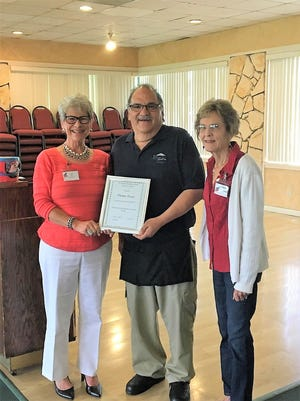 """Members of the Federated Republican Women of Lincoln County presented Thomas Tsosie, Cree Meadows Golf and Country Club host, with an honorary membership for his """"extraordinary acts of kindness and efforts on behalf of the club."""""""