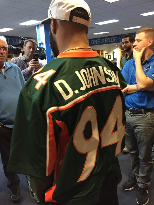 636469668164945888-golden-tate-lions-IMG-0841.jpg. Lions receiver Golden  Tate pays off a bet to Dwayne (The Rock) Johnson by wearing his Miami ... 704c5d904