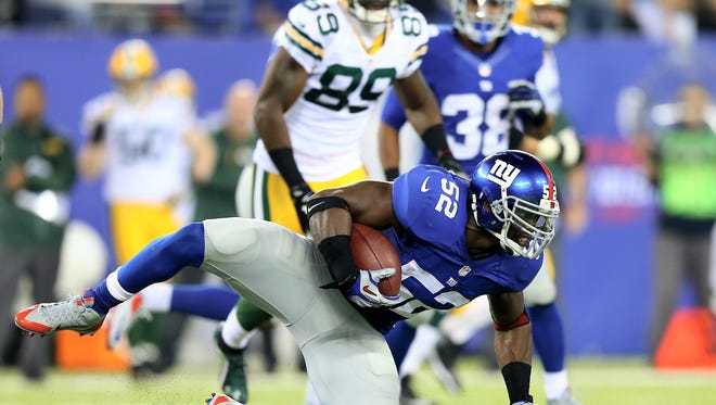 Jon Beason intercepts a pass from Scott Tolzien of the Green Bay Packers at MetLife Stadium on November 17, 2013 in East Rutherford, New Jersey.The New York Giants defeated the Green Bay Packers 27-13.