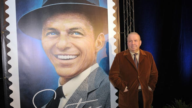 Frank Sinatra's son Frank Jr. poses in front of  the new United States Postal Service stamp in tribute to his father, 12 December 2007 in Beverly Hills, California.