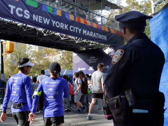 A New York City police office stands near the finish