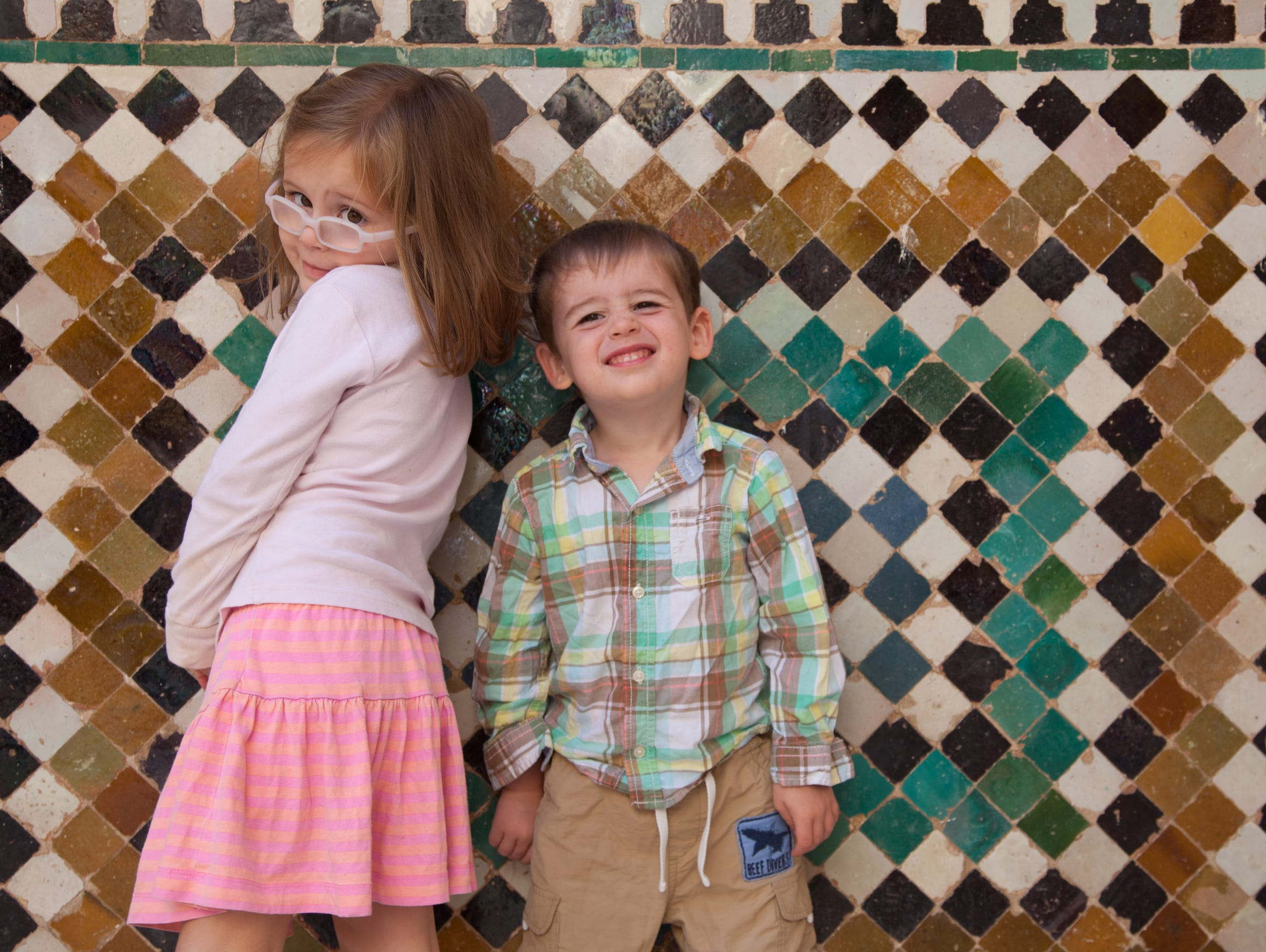 Harper and Walker Hughey in front of the glazed tiles