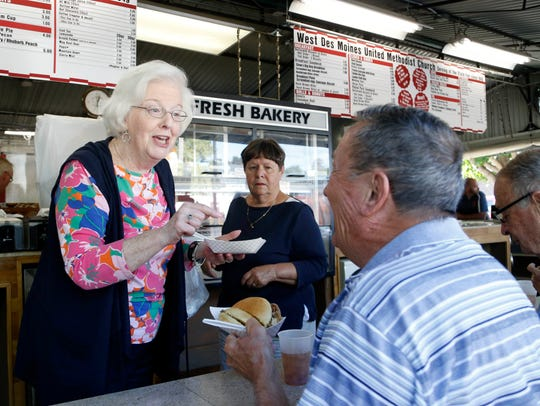 Volunteer Kay Rosene offers up some biscuits and gravy