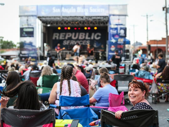 People gather on Oakes Street for the Simply Texas Blues Festival Saturday, May 19, 2018, in downtown San Angelo.