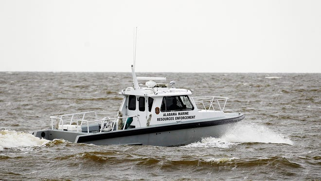 Search efforts were underway for four people missing after a deadly weekend storm Monday in Dauphin Island, Alabama.