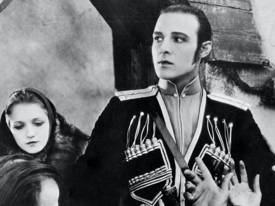 "Rudolph Valentino stars in ""The Eagle,"" playing at"