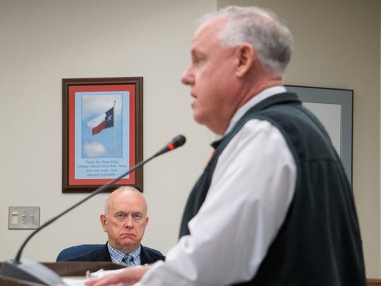 Nueces County Commissioner Mike Pusley (left) listens to Kevin Hannes, federal coordinating officer for Hurricane Harvey for FEMA in Texas, make a presentation about ongoing recovery efforts on Wednesday, Jan. 3.
