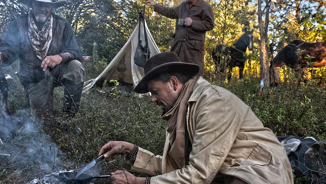 Tom Griesmer cooks bacon with his fellow cowboys at Old Falls Village Historical Park for the Wisconsin Artist Ride last year. This year's Artist Ride is Sept. 15-17.