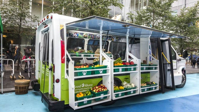 Muncie hopes to create a veggie food truck like this bus  converted into a mobile good food truck by FoodShare Toronto.