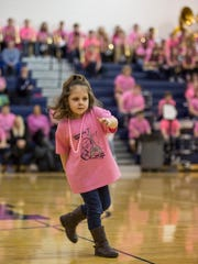 Addison Groulx, 5, dances by herself while her father