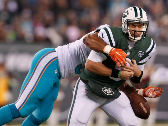 Jets quarterback Bryce Petty fumbling the ball as he