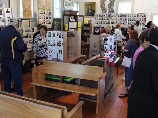 Visitors explore the veterans photo displays inside the Historical Society of Hammonton on Sunday afternoon.