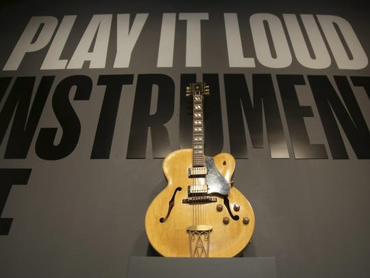 """A guitar played by Chuck Berry is displayed at the entrance to the exhibit """"Play It Loud: Instruments of Rock & Roll"""" at the Metropolitan Museum of Art in New York, Monday, April 1, 2019. The exhibit, which showcases the instruments of rock and roll legends, opens to the public on April 8 and runs until Oct. 1, 2019."""