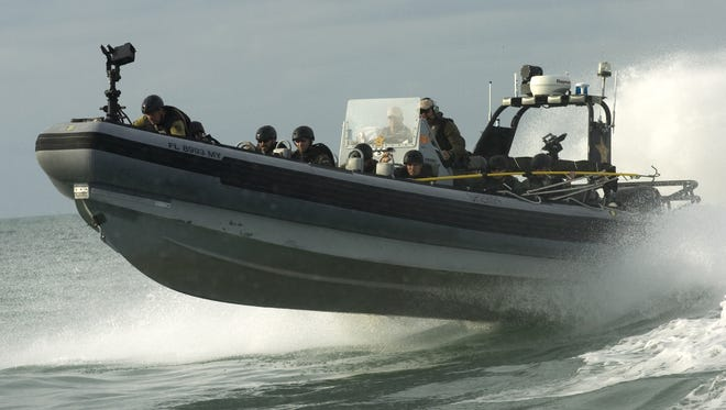 FILE--- MARC BEAUDIN/The News-Press...Law enforcement officers race in one of three boats before boarding the U.S. Coast Guard vessel Joshua Appleby during a Homeland Security's training program Thurday off Lee County in the Gulf of Mexico.The Lee County Sheriff Office is the trainer for this Maritime Tactical Operations/Armed Ship course that brought officers as far as Canada and Macedonia. Twenty one officers were training in this program including this simulation of an hostage take over on a boat offshore, in this case the Appleby, a 175 feet cutter was used for the training.This training covers cutting edge Maritime /Armed ship course, water safety and survival techniques, overturned vessel, helicopter egress, combat swimming, intelligence gathering and mission planning.