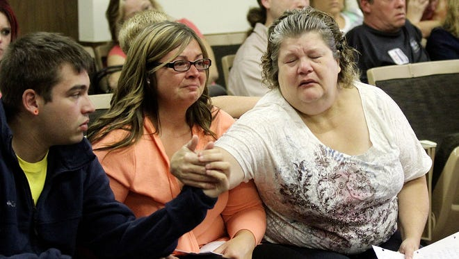 Quinton Owens, left, Rachel Hill and Carolyn Richie react after Robert Persinger Jr. was sentenced to 23 years in prison in Common Pleas Judge Jim Slagle's courtroom on Thursday, Aug. 13, 2014. The family later learned that three sentences will run concurrent, resulting in Persinger serving 9 years in prison for the vehicular homicide deaths of Jarred Bullion and Eric Richie and for injuring Quinton Owens in a crash on Dec. 18, 2013. James Miller/The Marion Star