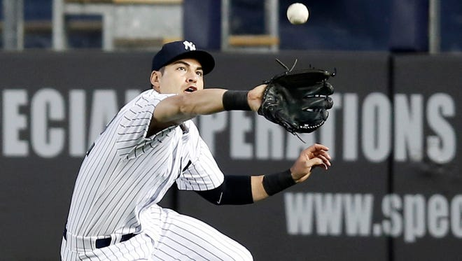 The Yankees' Jacoby Ellsbury fields a Juan Lagares third-inning sacrifice fly in a game against the Mets at Yankee Stadium on Tuesday.