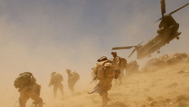A CH-47 Chinook helicopter lifts off after dropping off soldiers in Zabul province in 2005, the same location of today's crash.