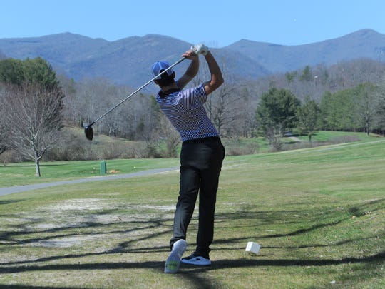 Junior Garrett Miller tees off on the 11th hole of the Black Mountain Golf Course on May 23. Miller finished 20th in the state as a sophomore.