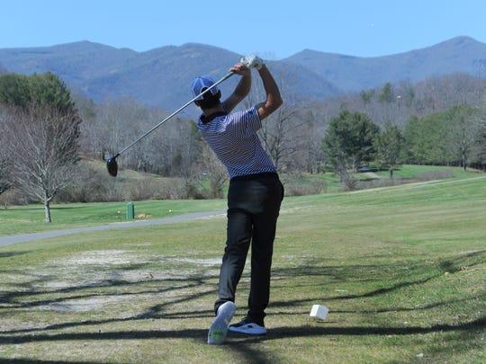 Junior Garrett Miller tees off on the 11th hole of