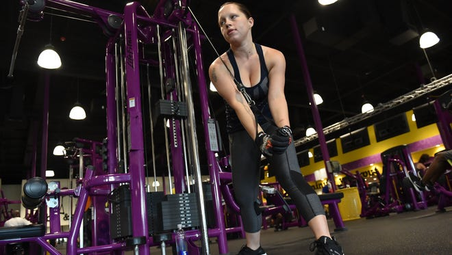 "Rebecca Lauber, 23, of Jupiter, spends her morning working out at Planet Fitness on Tuesday, July 25, 2017, in Palm Beach Gardens. Lauber has a rare autoimmune condition, Polyglandular Autoimmune Syndrome Type 1, that affects many of the body's organs. ""My body attacks itself and I lose my electrolytes and my calcium, so it's important that I stay active and eat right,"" Lauber said. ""I work out and try to stay healthy so that I'm not defined by my illness, and I want to encourage others to get out and be active and stay healthy and not be defined by their illnesses either."""