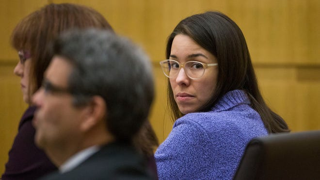 Jodi Arias looks back towards the camera during her sentencing retrial in Maricopa County Superior Court in Phoenix, Monday, November 24, 2014.