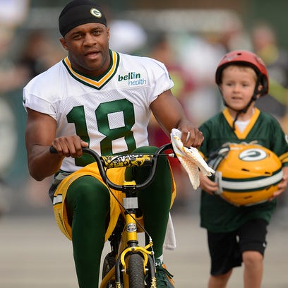 Green Bay Packers receiver Randall Cobb rides a bicycle to training camp practice on Saturday, July 26, 2014. Evan Siegle/Press-Gazette Media