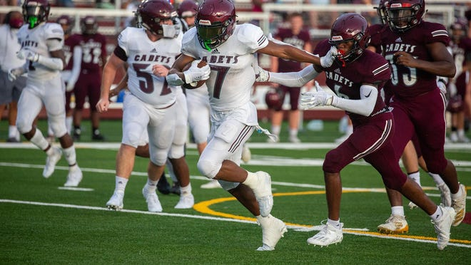 LeShon Brooks (7) runs as Jakobe Gadsden defends during the Benedictine Maroon vs. White scrimmage at Benedictine on Friday night.