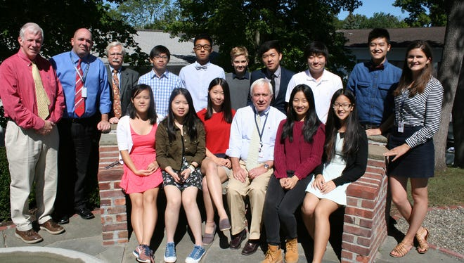 This year's international students are joined by Harvey Headmaster Barry Fenstermacher (front row), and Admissions Director Bill Porter, Upper School Head Phil Lazzaro, International Student Program Director, Bob Cook, and Associate Director of Admissions and Associate Director of the International Student Program Julia Gooding (back row).