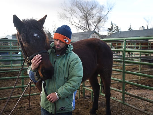 Trainer Kirk Ferris shares a quiet moment with Judd after struggling to put on his bridle during a session on March 12, 2016.