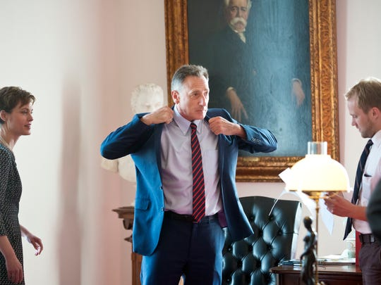 Gov. Peter Shumlin dons his suit jacket before addressing the House of Representatives as the legislature adjourned at the Statehouse in Montpelier on May 10.