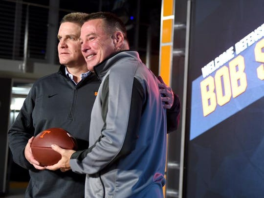 Tennessee coach Butch Jones, right, poses with the