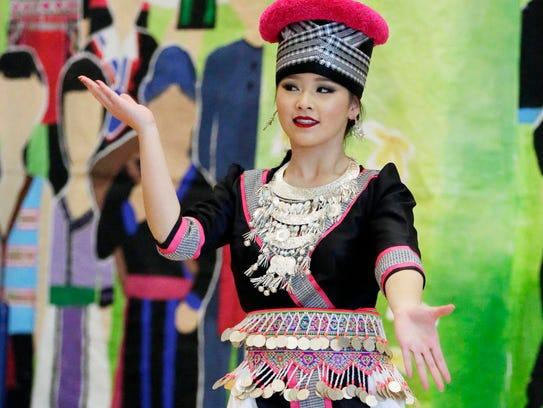 Nikkin Chang performs during the Hmong-American Leadership