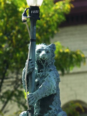 Bear sits on top the light pole of the water fountain on Main Street in this file photo.