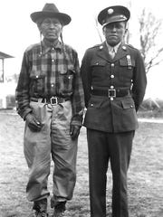 Jicarilla Apache Chief James Garfield Velarde poses with his son, James Garfield Velarde Jr, who was on leave from the U.S. Army during World War II.